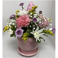 pink-and-purple-mixed-bouquet-in-pink-ribbon-container